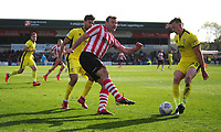 Lincoln City's Matt Rhead under pressure from Cheltenham Town's William Boyle<br /> <br /> Photographer Andrew Vaughan/CameraSport<br /> <br /> The EFL Sky Bet League Two - Lincoln City v Cheltenham Town - Saturday 13th April 2019 - Sincil Bank - Lincoln<br /> <br /> World Copyright © 2019 CameraSport. All rights reserved. 43 Linden Ave. Countesthorpe. Leicester. England. LE8 5PG - Tel: +44 (0) 116 277 4147 - admin@camerasport.com - www.camerasport.com