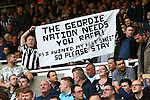 Fans hold up a banner in support of Rafa Benitez, manager of Newcastle United during the Barclays Premier League match at St James' Park. Photo credit should read: Philip Oldham/Sportimage