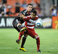 FC Dallas forward David Ferreira (10) shields the ball against DC United defender Devon McTavish (18)   FC Dallas defeated DC United 3-1 at RFK Stadium, Saturday August 14, 2010.