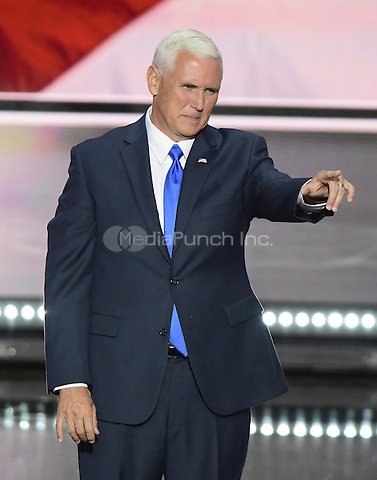 Governor Mike Pence (Republican of Indiana), the GOP nominee for Vice President of the United States acknowledges the crowd following his acceptance speech at the 2016 Republican National Convention held at the Quicken Loans Arena in Cleveland, Ohio on Wednesday, July 20, 2016.<br /> Credit: Ron Sachs / CNP/MediaPunch<br /> (RESTRICTION: NO New York or New Jersey Newspapers or newspapers within a 75 mile radius of New York City)