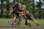 F. Pahulu gets sandwiched in a tackle from 2 Bombay players. Counties Manukau Premier 2 Championship game between Bombay and Papakura played at Bombay on May 13th, 2006. Papakura won 8 - 7.