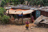 Nepal, Gorkha, Sindhulpalchowk. Area that was heavily damaged in the earthquake and in the process of being rebuilt. Locals in their damaged homes.
