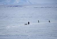 Koyuk Children Ski After Mitch Seavey on Ice