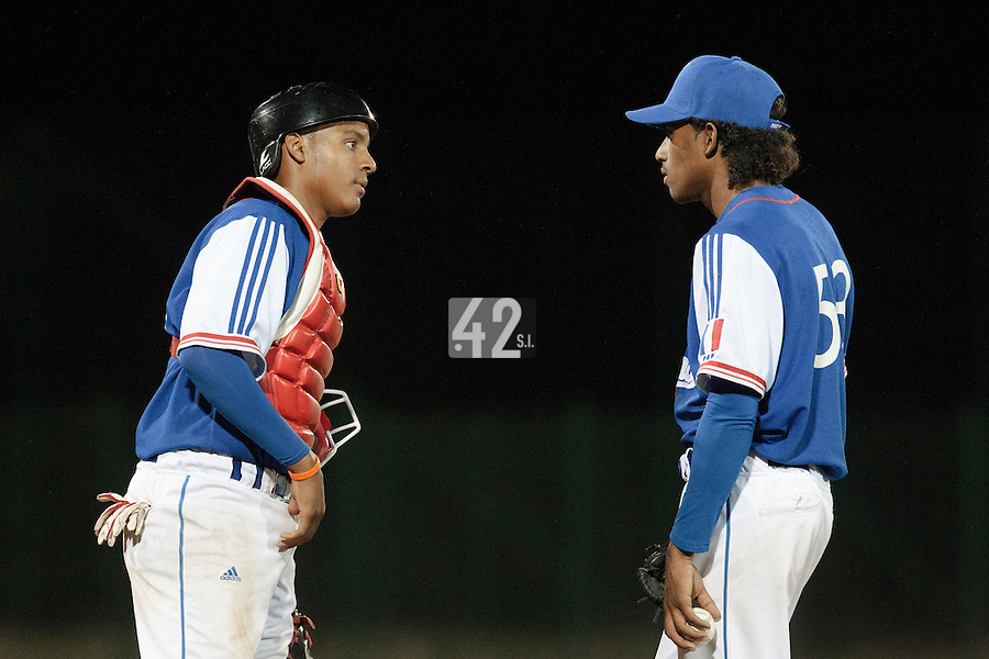 17 August 2010: David Van Heyningen of Team France talks to Andy Paz Garriga as he pitches against Czech Republic during the Czech Republic 4-3 win over France, at the 2010 European Championship, under 21, in Brno, Czech Republic.