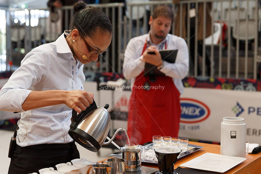 MELBOURNE, AUSTRALIA - MAY 23 Graciele Rodrigues from Brazil in action on day one of the 2013 World Barista Championship at the Melbourne Showgrounds, Australia. Photo Sydney Low / syd-low.com