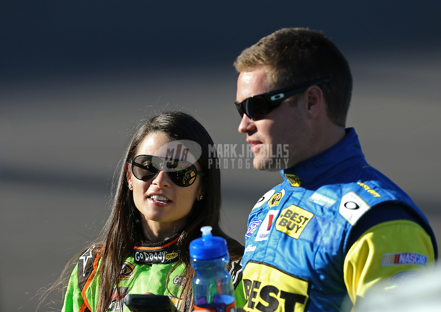 Mar. 1, 2013; Avondale, AZ, USA; NASCAR Sprint Cup Series driver Danica Patrick (left) with boyfriend Ricky Stenhouse Jr during qualifying for the Subway Fresh Fit 500 at Phoenix International Raceway. Mandatory Credit: Mark J. Rebilas-