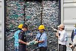 18 September 2019, Jakarta, Indonesia: A dock worker shows Director General of Customs and Excise Hero Pambudi  containers of domestic waste that was sent to Indonesia for processing by Australia. It is being returned after inspection by Indonesian authorities who uncovered illegal waste hidden in among the genuine waste. After a huge outcry at the illegal waste being sent from Australia the Australian Government has stopped export of waste overseas to be processed domestically instead. Picture by Graham Crouch/The Australian