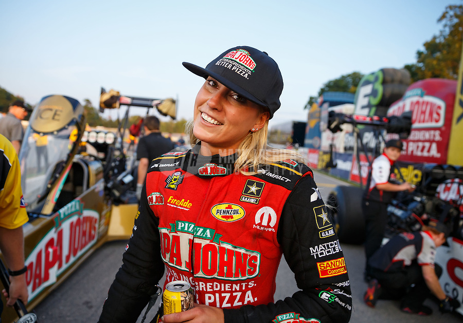 Aug 18, 2017; Brainerd, MN, USA; NHRA top fuel driver Leah Pritchett celebrates after setting a new national record time of 3.640 during qualifying for the Lucas Oil Nationals at Brainerd International Raceway. Mandatory Credit: Mark J. Rebilas-USA TODAY Sports