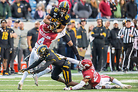 Arkansas Democrat-Gazette/Jeff Gammons - 11/29/19 - University of Missouri wide receiver Tauskie Dove (86) catches a pass under coverage by University of Arkansas  defensive backs Jarques McClellion (4) and Micahh Smith  (26) during the Battle Line Rivalry game at War Memorial Stadium in Little Rock on Friday November 29th 2019. To view more photos visit arkansasonline.com/1130uamiz/