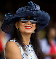 BALTIMORE, MD - MAY 20: A woman wearing a blue festive hat poses for a photo in the grandstand on Preakness Stakes Day at Pimlico Race Course on May 20, 2017 in Baltimore, Maryland.(Photo by Scott Serio/Eclipse Sportswire/Getty Images)
