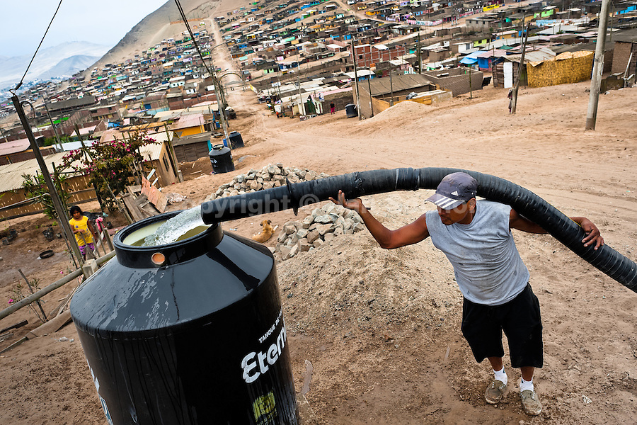 A Peruvian water distribution worker with a pipe fills a tank with drinking water on the dusty hillside of Pachacútec, a desert suburb of Lima, Peru, 21 January 2015. Although Latin America (as a whole) is blessed with an abundance of fresh water, having 20% of global water resources in the the Amazon Basin and the highest annual rainfall of any region in the world, an estimated 50-70 million Latin Americans (one-tenth of the continent's population) lack access to safe water and 100 million people have no access to any safe sanitation. Complicated geographical conditions (mainly on the Pacific coast), unregulated industrialization (causing environmental pollution) and massive urban poverty, combined with deep social inequality, have caused a severe water supply shortage in many Latin American regions.