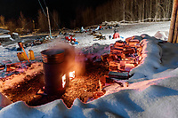 Dog water stays hot in barrels as mushers prepare to leave the Takotna checkpoint after their 24-hour layover on Thursday, March 8th during the 2018 Iditarod Sled Dog Race -- Alaska<br /> <br /> Photo by Jeff Schultz/SchultzPhoto.com  (C) 2018  ALL RIGHTS RESERVED