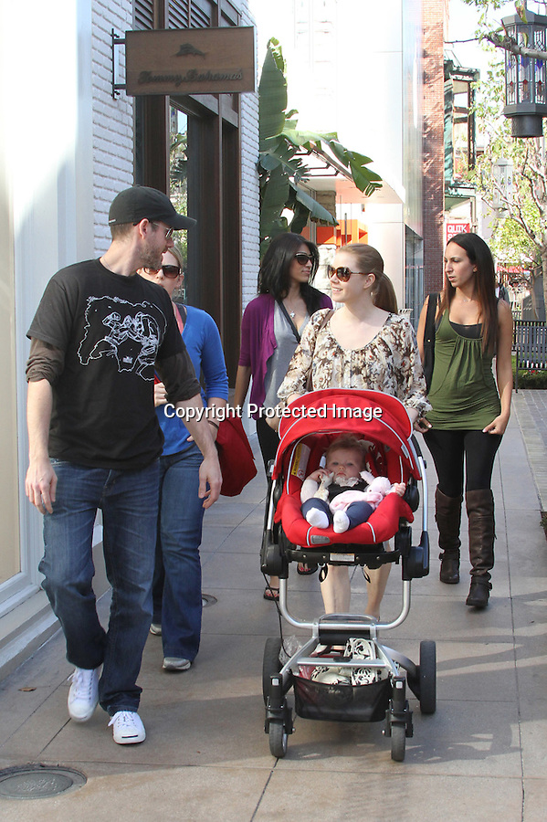 February 9th 2011..Amy Adams went shopping at the Apple Store at the Grove shopping center in Los Angeles . Amy was pushing her baby Aviana Olea with boyfriend Darren Le Gallo in a stroller with her family. Amy was laughing & smiling tossing her baby up in the air while testing out some computers inside the store. ..AbilityFilms@yahoo.com.805-427-3519.www.AbilityFilms.com