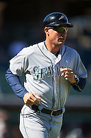Peoria Javelinas coach Yoel Monzon (38), of the Seattle Mariners organization, jogs on the field during a game against the Surprise Saguaros on October 20, 2016 at Surprise Stadium in Surprise, Arizona.  Peoria defeated Surprise 6-4.  (Mike Janes/Four Seam Images)