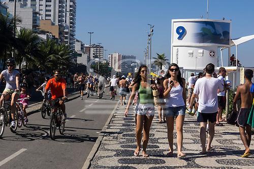Rio de Janeiro, Brazil. Crowded Ipanema cycle lane and pavement by Posto 9.