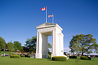 Peach Arch (Canadian Side) at Canada - United States Border, Peace Arch Provincial Park, Surrey (near White Rock), BC, British Columbia, Canada - Peace Arch International Border Crossing / Douglas Border Crossing.  Beyond Monument (built 1921) is Peace Arch State Park, Blaine, WA, Washington, USA
