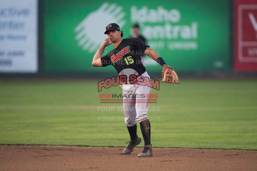 Great Falls Voyagers second baseman Amado Nunez (15) throws to first base during a Pioneer League game against the Idaho Falls Chukars at Melaleuca Field on August 18, 2018 in Idaho Falls, Idaho. The Idaho Falls Chukars defeated the Great Falls Voyagers by a score of 6-5. (Zachary Lucy/Four Seam Images)