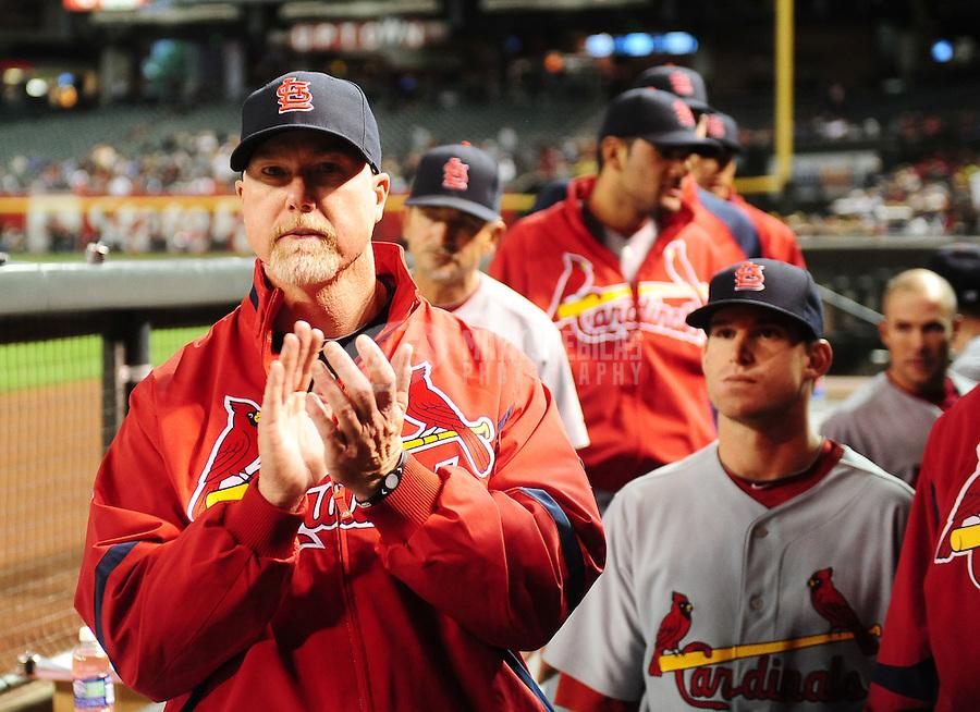 Apr. 21, 2010; Phoenix, AZ, USA; St. Louis Cardinals hitting coach Mark McGwire (left) against the Arizona Diamondbacks at Chase Field. The Cardinals defeated the Diamondbacks 9-4. Mandatory Credit: Mark J. Rebilas-