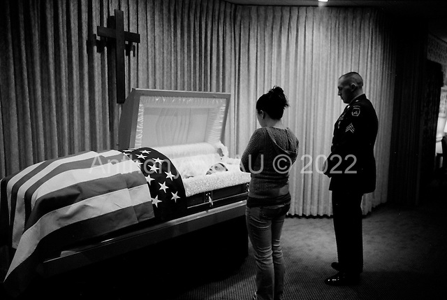 Salisbury, Maryland.USA.March 19, 2007..Rachel Guy-Latham, 22 views the body of her husband Sgt. Thomas Lee Latham, 23, of Delmar, Md., in the funeral home for the first time. ..Sgt. Thomas Lee died March 11 in Baghdad, Iraq, of wounds sustained when an improvised explosive device detonated near his humvee. He was assigned to the 2nd Battalion, 14th Infantry Regiment, 2nd Brigade Combat Team, 10th Mountain Division, Fort Drum, N.Y.