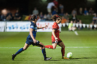 Kansas City, Mo. - Saturday April 23, 2016: Portland Thorns FC forward Hayley Raso (21) and FC Kansas City defender Amanda Frisbie (17) during a match at Swope Soccer Village. The match ended in a 1-1 draw.