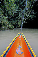 PANGASINAN WATERFALL in the Philippines with a traditional boat in the forground