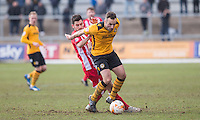Danny Holmes of Newport County under pressure from Seamus Conneely of Accrington Stanley during the Sky Bet League 2 match between Newport County and Accrington Stanley at Rodney Parade, Newport, Wales on 28 March 2016. Photo by Mark  Hawkins.