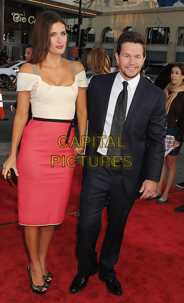"Rhea Durham, Mark Walhberg.arriving at the World Premiere of ""Ted"" at Grauman's Chinese Theatre in Hollywood, California, USA, .June 21st, 2012. .full length suit tie   navy blue white shirt black husband wife couple white off the shoulder red skirt dress couple straps pink  .CAP/ROT/TM.©TM/Roth Stock/Capital Pictures"