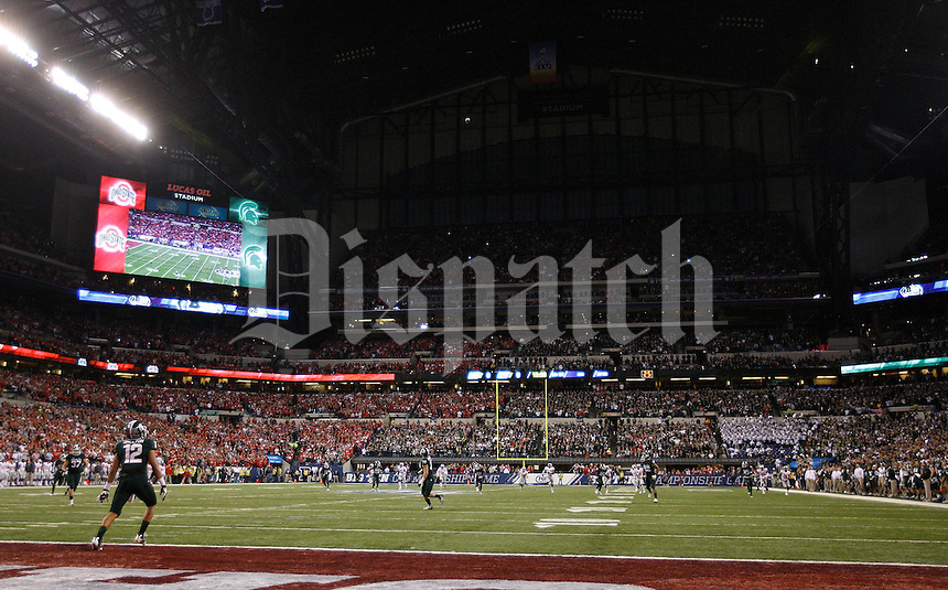 The kick off to start the first half of the Big Ten Championship football game at Lucas Oil Stadium in Indianapolis on Friday, December 7, 2013. (Columbus Dispatch photo by Jonathan Quilter)