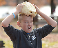 NWA Democrat-Gazette/ANDY SHUPE<br /> Alex Harris, 10, a fifth-grade student at Lincoln Middle School, tries on an alligator snapping turtle skull Wednesday, Nov. 7, 2018, during Forest Appreciation Day sponsored by the Arkansas Forestry Association Education Foundation at Lake Wedington in Washington County.