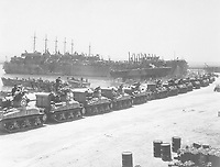 L.S.T.'s lined up and waiting for tanks to come aboard.  Two days before invasion of Sicily.  La Pecherie, French Naval Base. Tunisia, July 1943.  (OSS)<br /> Exact Date Shot Unknown<br /> NARA FILE #:  226-FPL-2665(A)<br /> WAR & CONFLICT BOOK #:  1022