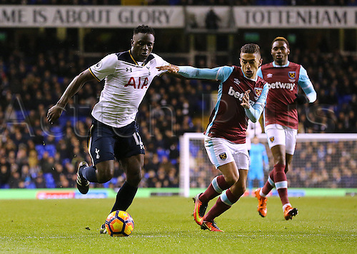19.11.2016. White Hart Lane, London, England. Premier League Football. Tottenham Hotspur versus West Ham United. Tottenham Hotspur Midfielder Victor Wanyama feels pressure from West Ham United Midfielder Manuel Lanzini during a Tottenham attack