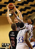 Cougars centre Tim Behrendorff beats Mike Efevberha to the ball during the NBL match between the Wellington Saints and Christchurch Cougars at Te Rauparaha Stadium, Porirua, Wellington, New Zealand on Saturday 4 April 2009. Photo: Dave Lintott / lintottphoto.co.nz