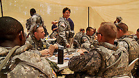 Brigadier General Maria L. Britt (center), Commanding General of the Georgia Army National Guard, visits with soldiers on a lunch break as they practice scenarios at Camp Shelby, Mississippi on Friday, May 8, 2009 in preparation for their deployment to Afghanistan. Their mission is to help train the Afghan National Army and Police forces. Foreign nationals and Mississippi locals act as townspeople, police and soldiers during the scenarios...Still image taken from video.