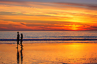 Couple Walking on the Beach During Sunset at Low Tide in San Clemente