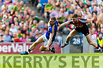 Peter Crowley Kerry has a shot at goal despite the attention of Seamus O'Shea Mayo in the All Ireland Semi Final Replay in Croke Park on Saturday.