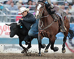 Corey Rogers competes in the steer wrestling event at the Reno Rodeo, in Reno, Nev. on Friday night, June 22, 2012..Photo by Cathleen Allison