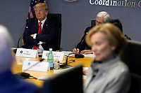 United States President Donald J. Trump, left, attends a teleconference with governors at the Federal Emergency Management Agency headquarters, Thursday, March 19, 2020, in Washington, DC<br /> Credit: Evan Vucci / Pool via CNP/AdMedia