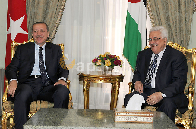 Turkish prime minister Recep Tayyip Erdogan meets with Palestinian Mahmoud Abbas during his three days visit, in Cairo, Egypt on Sep. 14,2011. Abbas, who arrived in Cairo on 12 September, met with Arab League officials as well with EU Foreign Affairs Chief Catherine Ashton, some one week ahead of his bid to gain recognition of statehood and membership from the United Nations General Assembly on 19 September. Photo by Thaer Ganaim