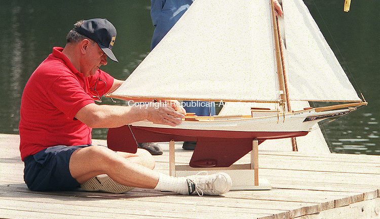 SOUTHBURY,CT. 8/30/98--0830sv15.tif-- (cq) Sal Raciti of Hert. Village gets ready to pilots his sail boat during the mini boat regatta at the meeting house pond in Heritage Village , Southbury on Sunday. Steven Valenti photo for Country Life