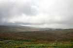 Grey overcast weather clouds hanging over moorland, Dartmoor national park, near Postbridge, Devon, England, UK