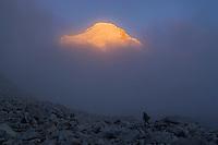 A Man Hiking in the Himalaya Mountains of Tibet