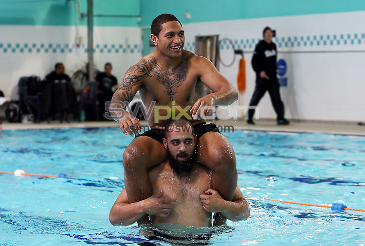 Picture by Vaughn Ridley/SWpix.com - 26/11/2013 - Rugby League - Rugby League World Cup - New Zealand Training - Leigh Sports Village, Leigh, England - New Zealand's Manu Vatuvai and Sam Kasiano enjoy a dip in the pool after training.