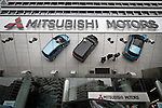 June 13th, 2011, Tokyo, Japan - Japan's Mitsubishi Motors Corp. forecasts full-year profit may rise 28 percent on higher overseas sales during a news conference in Tokyo on Monday, June 13, 2011. The maker of the i-MiEV electric car postponed its profit forecast from April 27 as it assessed the impact of the March 11 earthquake and tsunami that devastated Japan's northeastern region. Mitsubishi slowed down production amid a shortage of parts, but the automaker said it hopes to increase sales in the current year in North America, Asia and Europe. (Photo by AFLO) [3609]