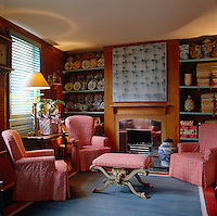 Antique china plates and Picasso ceramics adorn the shelves either side of the fireplace in the ground floor sitting room
