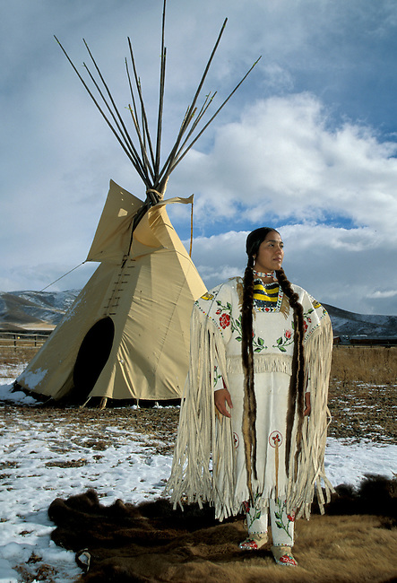 Rand'l Hedow Teton (Shoshone Cree) is the model for the likeness of the Sacajawea gold coin dollar. Here she is dressed in traditional dress with beadwork done by her grandmother Juanita Teton