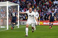 Zlatan Ljubijankic of Slovenia celebrates scoring the second goal against USA