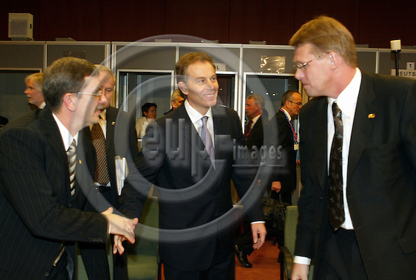 BRUSSELS - BELGIUM - 25 MARCH 2004-- EU-Summit during the Irish Presidency.-- The British Prime Minister Tony BLAIR (C) greeting Einars REPSE the Latvian Prime Minister. Finnish Prime Minister Matti VANHANEN (R) waiting for his turn. -- PHOTO: JUHA ROININEN / EUP-IMAGES