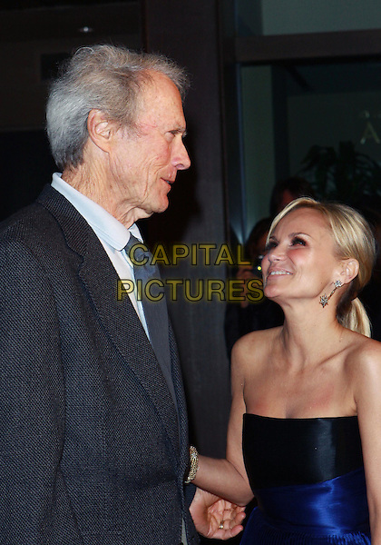 CLINT EASTWOOD & KRISTIN CHENOWETH .Annual Backstage At The Geffen Gala -Arrivals held at The Geffen Playhouse, Westwood, California, USA, .22nd March 2010..half length black jacket grey gray shirt tie blue strapless profile side .CAP/ADM/TC.©T. Conrad/AdMedia/Capital Pictures.