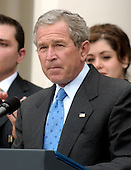 Washington, D.C. - March 29, 2005 -- United States President George W. Bush makes remarks on freedom and democracy in the Rose Garden at the White House on March 29, 2005. The President was surrounded by Iraqi nationals, some who live in the United States, who voted in the recent Iraqi elections. <br /> Credit: Ron Sachs / CNP