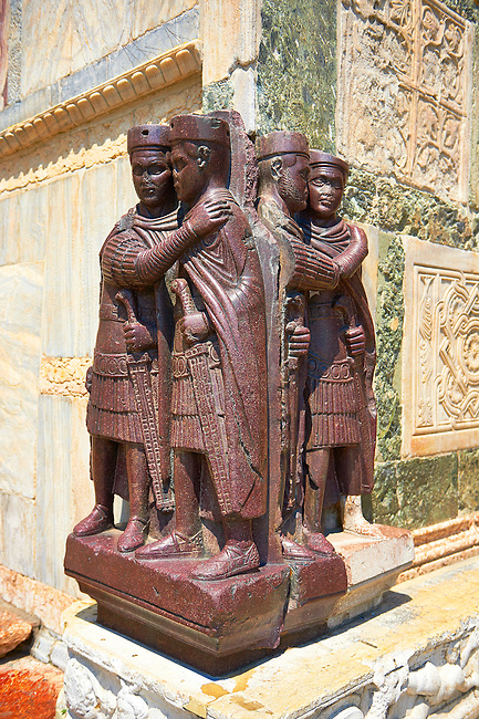 The Tetrach Statues showing the Emperor Diocletian and his co Emperor  Maximian embrassing  in friendship ( foreground) sculpted in Egyptian porphyry stone. The staues were looted from Constantinople after the Fourth Crusade (1202-1204) and probably decorated the columns of the porch of the Philadelphion. Now on a corner of  St Mark's Basilica Venice